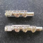 student flute C foot (above) vs intermediate flute B foot (below)